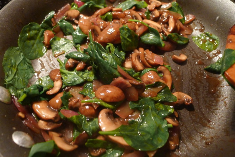 Butter and olive oil help to caramelize mushrooms, onions and to wilt the spinach