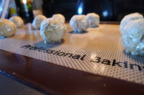 Rolling your dough into balls with slightly damp hands helps to prevent sticking.