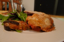 I served my eggplant parmesan with a rustic Italian loaf, and a leafy green salad with a homemade mustard vinaigrette